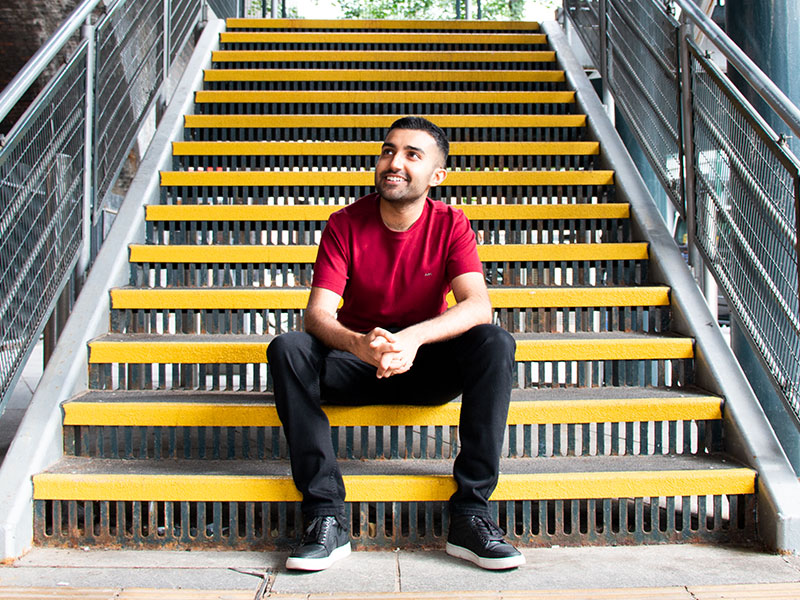 A man sat on yellow steps in Nottingham